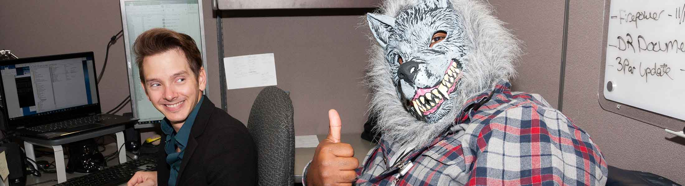 An employee in costume as a werewolf on Halloween
